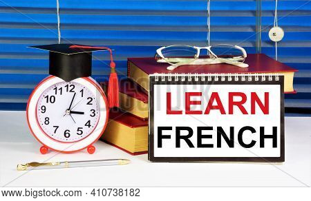 Learn French. The Inscription Of The Text On The Notepad. The Study Of The Sign System Of Recording