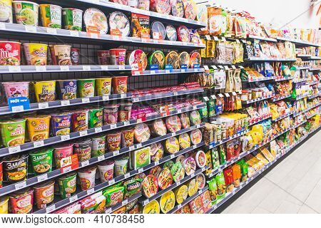 Instant Noodles And Snack On Supermarket Shelves Background,snack And Noodle Cup Sale On The Shelf I