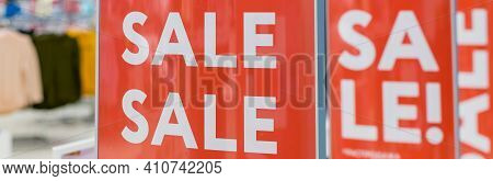 Red Bright Sale Banner On Anti-thieft Gate Sensor At Retail Shopping Mall Entrance.seasonal Discount