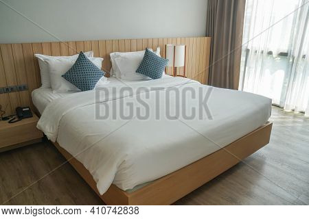 Minimal Double Bed With White Mattress In Luxury Hotel Bedroom