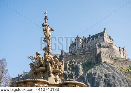 The Ross Fountain And Edinburgh Castle In Edinburgh, Scotland