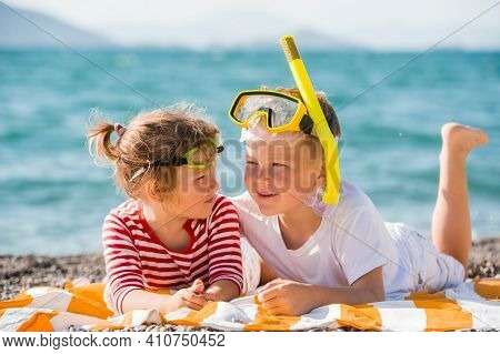 Happy Little Boy And Girl With Snorkels On Sandy Beach. Summer Holidays On The Sea. Smiling Kid In G