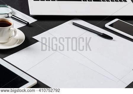 Top View Of Designer Workplace With Modern Digital Devices. Flat Lay Stylish Design With Black Surfa