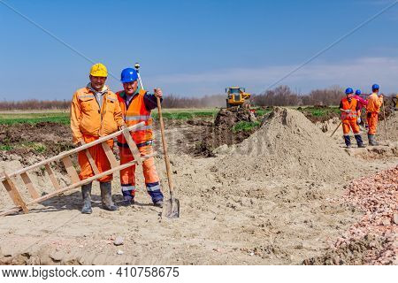 Zrenjanin, Vojvodina, Serbia - March 30, 2018: Two Construction Workers Standing At Building Site, O