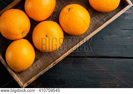Raw Organic Cara Navel Oranges Set, In Wooden Box, On Old Dark  Wooden Table Background, Top View Fl