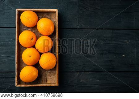 Raw Organic Cara Navel Oranges Set, In Wooden Box, On Black Wooden Table Background, Top View Flat L