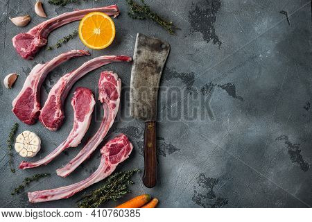 Fresh Raw Butchers Lamb Beef Cutlets Set, With Ingredients Carrot Orange, Herbs, And Old Butcher Cle