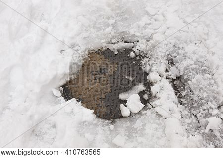 Sewer Surrounded By Snow. Winter Infrastucture Maintenance. Snowstorm