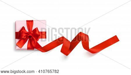 Pink Gift Box With Red Ribbon And Bow Isolated On White Background. Top View.