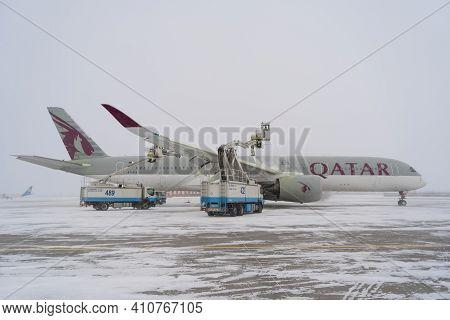 Ukraine, Kyiv - February 12, 2021: De-icing The Aircraft Before The Flight. The Deicing Machine Spri