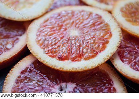 Grapefruit And Orange Half Isolated On White Background. Grapefruit Half Macro Studio Photo. Orange