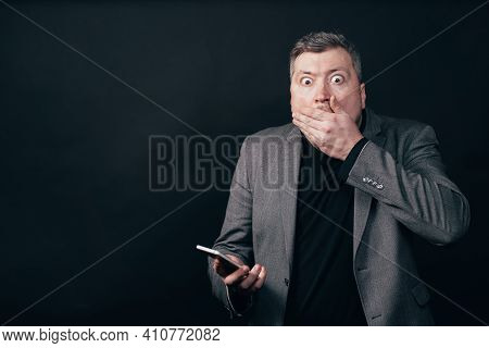 Frustrated Scared Man With Smart Phone. Shocking Content, Bad News, Social Media, Stress