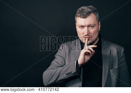 Confidential Information, Silence Concept. Portrait Of A Serious Business Man Showing Silence Gestur