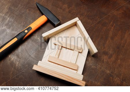 Model Of House And Hummer On A Wooden Background