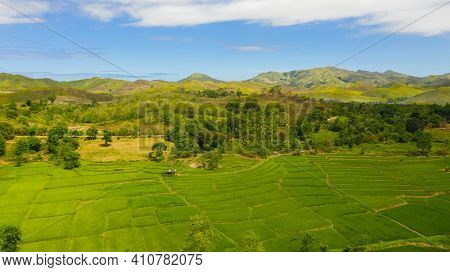 Summer Tropical Landscape. Green Hills And Mountains With Tropical Vegetation And Blue Sky With Clou
