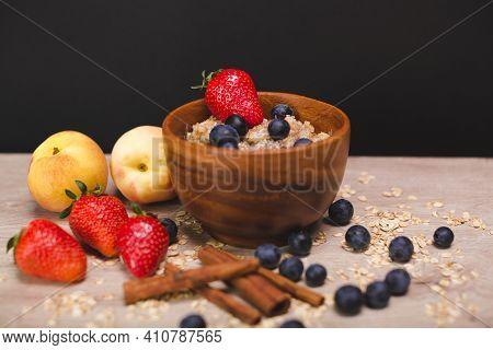 Still Life - Milk Porridge With Blueberries, Strawberries, Peaches And Cinnamon Sticks. Still Life I