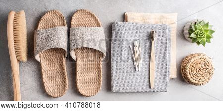 Eco Spa And Beauty Healthcare Bathroom Accessories On Grey Stone Background. Bamboo Slippers, Anti C