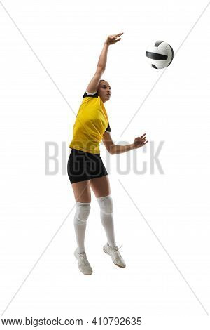 In Jump. Young Female Volleyball Player Isolated On White Studio Background. Woman In Sportswear Tra