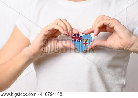 Flag Of Fiji In The Shape Of A Heart In The Hands Of A Girl. Love Fiji. The Concept Of Patriotism An