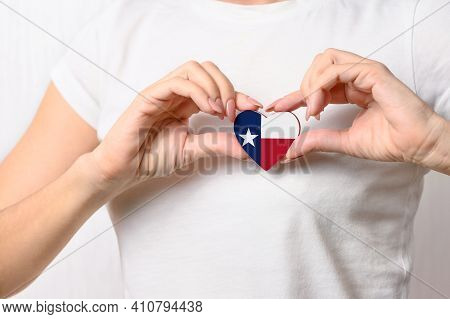 Flag Of The State Of Texas In The Shape Of A Heart In The Hands Of A Girl. Love Texas. The Concept O