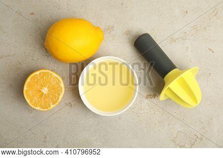 Freshly Squeezed Lemon Juice On Light Grey Table, Flat Lay