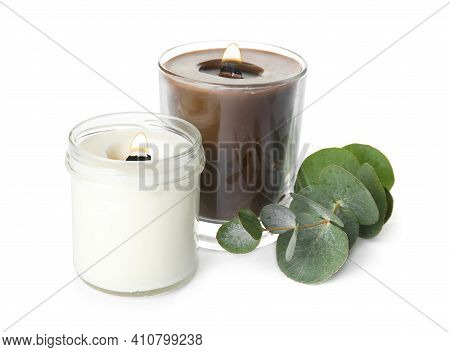 Aromatic Candles With Wooden Wicks And Eucalyptus Branch On White Background