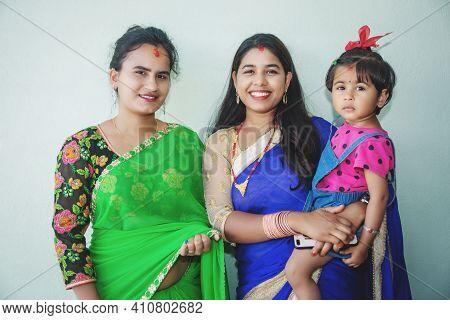 Portrait Of Beautiful Nepali Women In Traditional Nepali Attire In Sari. Asian Nepali Family