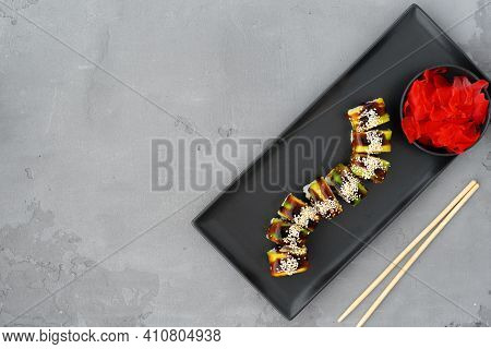 Vegeterian Sushi Roll With Vegetables On Gray Background