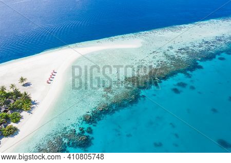 Aerial Beach Landscape. Relaxing Summer Vibes, Mood. Umbrellas With Chairs On White Sand Close To Bl