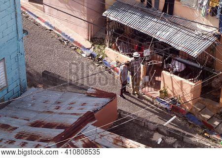 Santo Domingo, Dominican Republic - January 11, 2020: Locals Walk The Street Of Poor District Of San