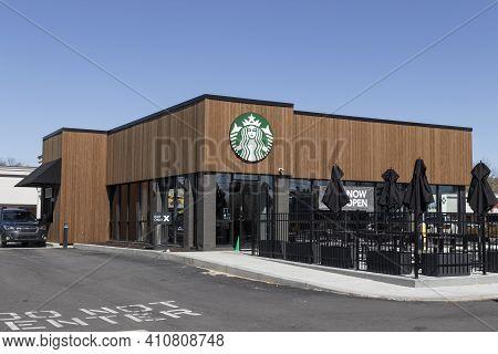 Indianapolis - Circa March 2021: Starbucks Retail Coffee Store. Each Year, Starbucks Celebrates Fall