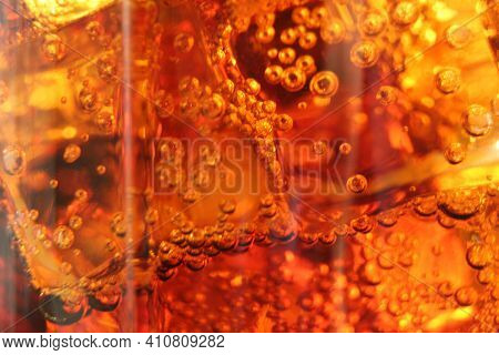 Macro Drink Kvass Coca-cola With Ice Close-up Bubbles In Drink Soda On A Dark Black Background