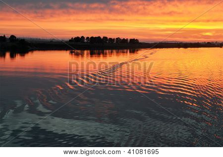 Beautiful Water At Sunrise On River