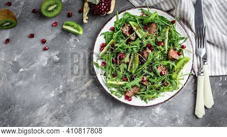 Salad With Chicken Liver. Fresh Vegetable Salad. Meat Salad With Liver, Kiwi And Pomegranate And Fre
