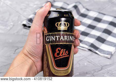 Tyumen, Russia-february 26, 2021: Gintarinis Elis Brown Ale Gubernija Gintarinis Elis Amber Ale