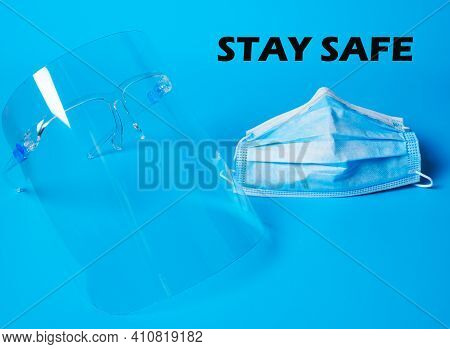 A Picture Of Face Shield And Face Mask On Blue Background. Face Shield And Face Mask Is Part Of Covi