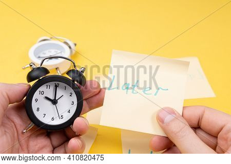 Alarm Clock With A Sticky Note With Text Later. Procrastination, Delay And Urgency Concept.