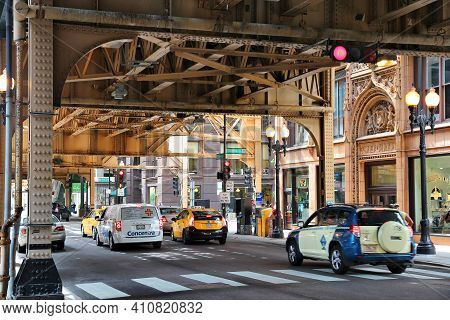 Chicago, Usa - June 26, 2013: Cars Drive Below Elevated Train Tracks In Chicago. Chicago Is The 3rd