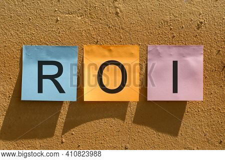 Acronym Roi - Return On Investment From Colorful Paper Notes On Wall.
