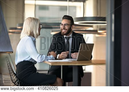 European Arabian Business Partners Negotiating Sit At Desk During Meeting