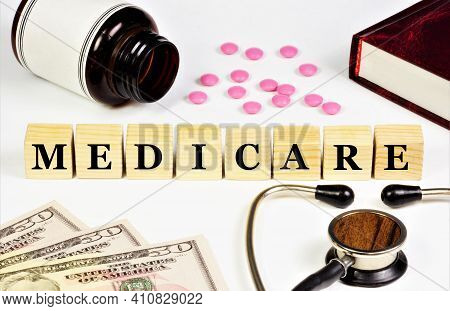Medicare. Text Inscription On The Background Of Medicines. Provides Well-being In Life Situations.