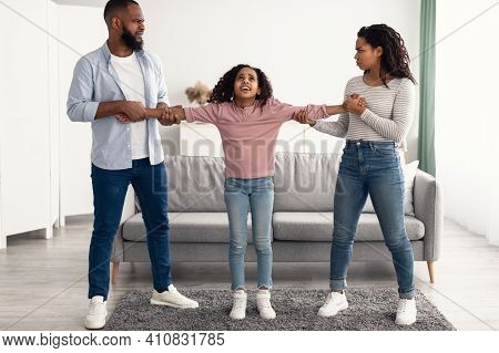 Divorce Concept. Portrait Of Angry African American Parents Fighting Over Their Child, Mad Man And W