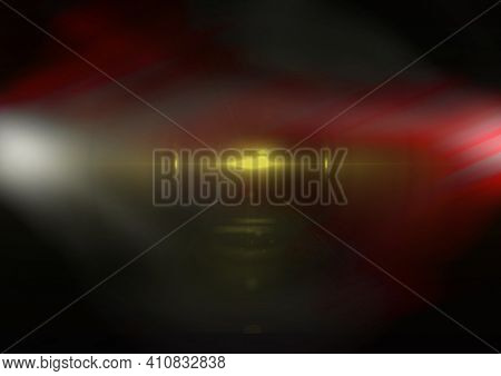 Glowing white, red and yellow spots of light and light trails over black background. light and colour concept digitally generated image.