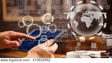 Interface showing globe information and scopes with hands of person using tablet. global communication technology digital interface concept, digitally generated image.