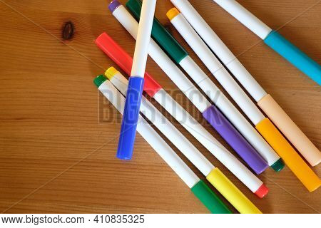 A Set Of Multicolored Felt Pens On A Wooden Table