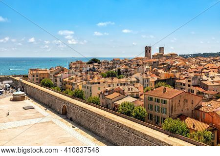 View from above on old town of Antibes under blue sky as Mediterranean sea on background on French Riviera.