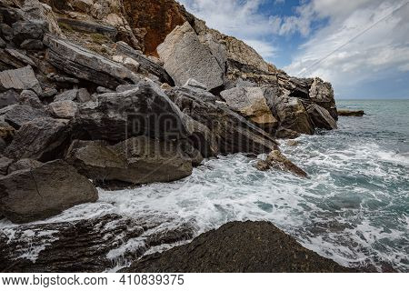 Seascape. Stormy Sea On A Windy Day: Blue Waves Breaks On The Stone Shore