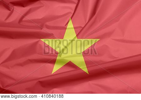 Fabric Flag Of Vietnam. Crease Of  Vietnamese Flag Background, Yellow Star On Red Flag.