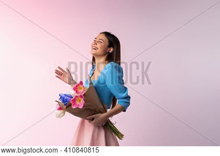 The Cheerful Girl, Good Mood, Smiles Positively, Dressed In Fashion Clothes, Bouquet Of Tulips, Meet