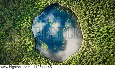 An Almost Perfect Circular Lake Shot Straight Down From The Air Resembles The Earth Surrounded By A